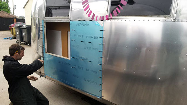A damaged Airstream is repaired in the ARC workshop