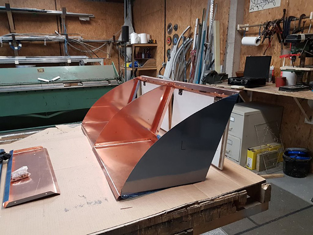 A copper thing being built in the workshop